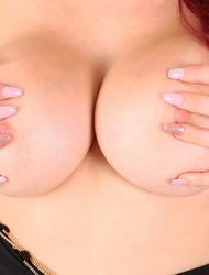 Busty Redhead Skyla Novea Strips Naked