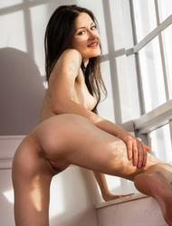 Skinny Brunette Kanda Spreads Her Long Legs