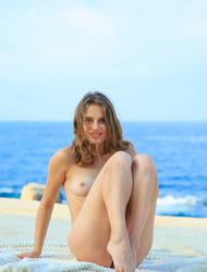 Slim Brunette Clarice Is Posing Naked By The Sea
