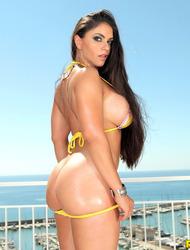 Big Boobed Brunette Gets Naked On A Terrace
