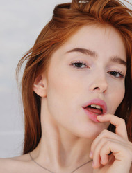 Porcelain pale beauty Jia Lissa lies on her bed in sexy blue lingerie