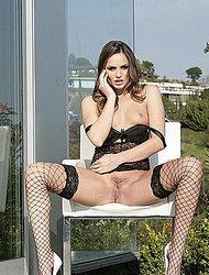 Tori Black stripping outdoors